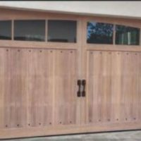 Add A Unique Pop To Your Home By Installing Wood Garage Doors